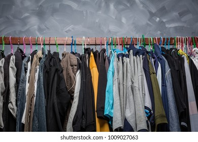 Clothes rack clothes were hanging by a variety of colors for men older Asians.