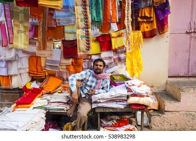 clothes seller in his shop  road Govardhan Parikrama Marg .India, Govardhan, November 2016