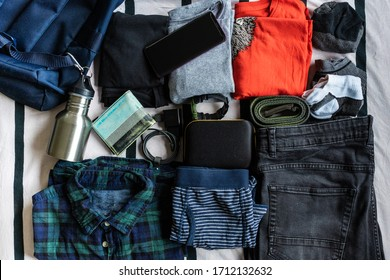 clothes and stuff for a travel backpack