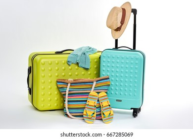 Clothes and suitcases for travelers. Accessories for summer tourism, white background.