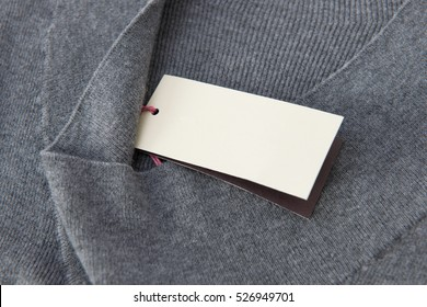 Clothes tag on grey color fabric