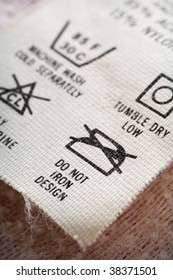 """clothes tag with washing and ironing instructions - focus on """"do not iron design"""""""