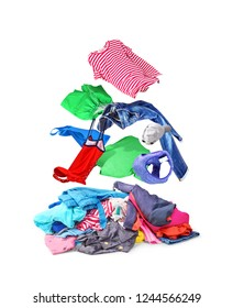 Clothes that fly on pile with things isolated on white background.