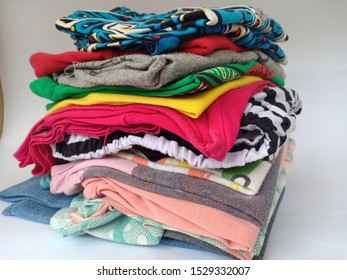 clothes that are neatly folded in the closet