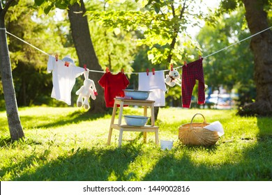 clothes and toys hanging on the clothesline in the summer outdoors. accessories to washing
