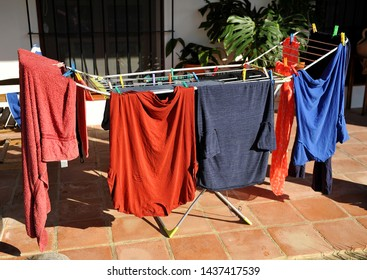 Clothes washed and laid in the sun for drying, portable drying rack at home