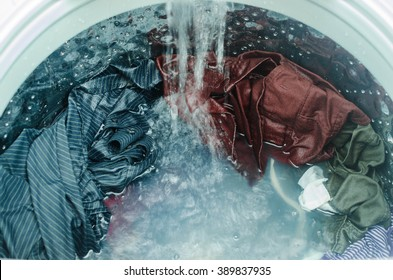 Clothes in washing machine. Laundry concept.