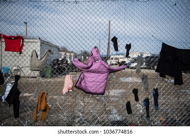 Clothes which belong to refugees drying on a fence, right on the borderline that splits Greece from the Republic of Macedonia, at the makeshift refugee camp of Idomeni in northern Greece.
