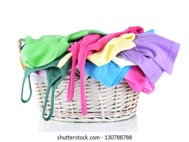 Clothes in wooden basket isolated on white