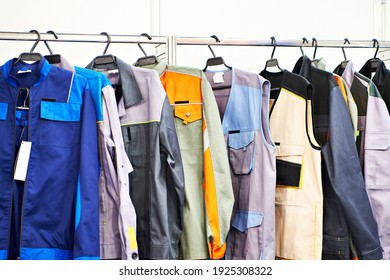 Clothes for workers on a hanger in shop