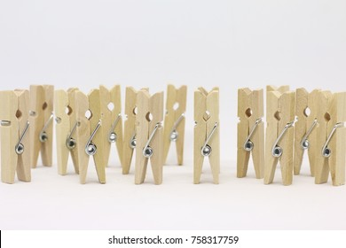 Clothespin made of wood on white background