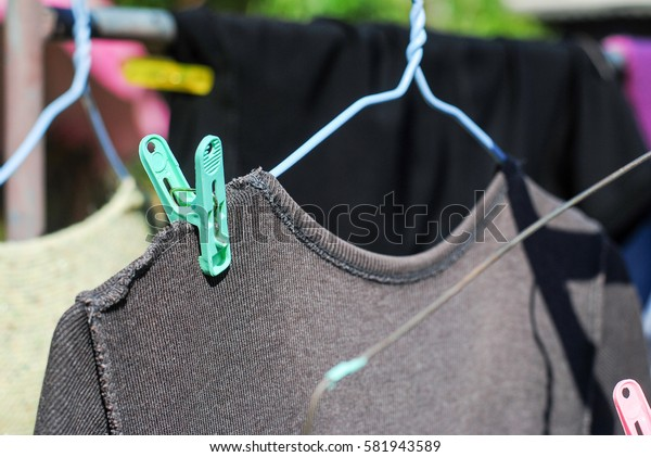 Clothespin on a clothes line.