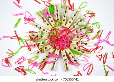 Clothespin on a white background colorful rubberband shooting in studio