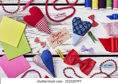 Clothespins, hearts and bow ties. Valentine's Day card and thread. Improve your crafting skills.