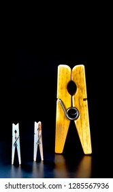 Clothespins on black background with room for your type.