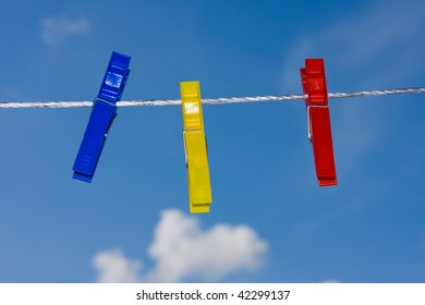 clothespins on sky background