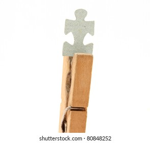 Clothespins and puzzle on a white background