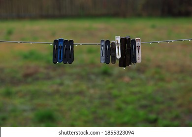 clothespins with water drops on the rope