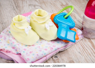 clothing and accessories for babies, toy beanbag and bottle of feeding