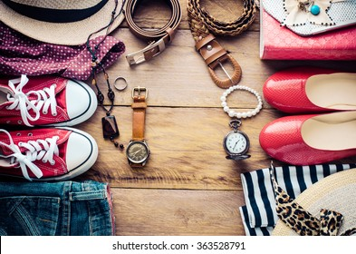 Clothing and accessories for men and women ready for travel.