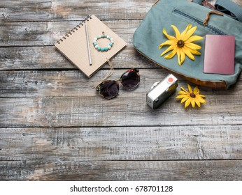 Clothing and accessories for women on vintage wooden background