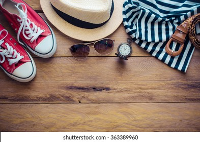 Clothing and accessories for women on wood floor