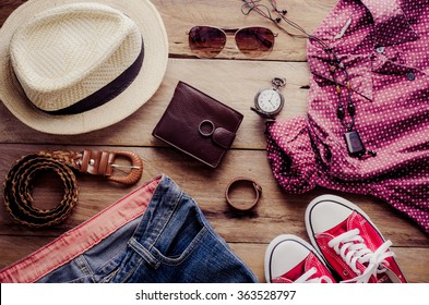 Clothing and accessories for womens on wood floor