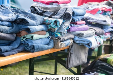 clothing collection like jeans, shirts and sweaters for the indigent or for sale at a flea market, selected focus, narrow depth of field