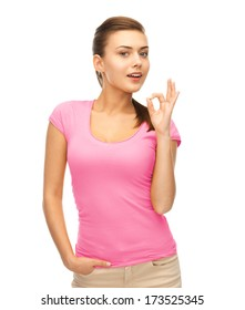 clothing design, health and breast cancer awareness concept - smiling girl in blank pink t-shirt showing ok gesture