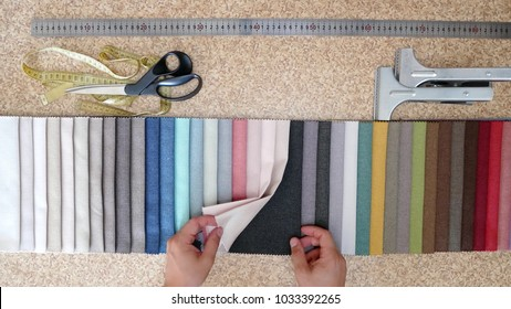 Clothing Designer Or Tailor Choose Textile Textures Fabric Swatches. Choice of Fabrics Tissue Samplesfor Upholstery Or Clothing. Set Of Fabric Samples