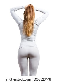 Clothing fashion sport concept. Fit female hips body wearing thermoactive underwear. Slim woman in sporty clothes, top and leggings, back view