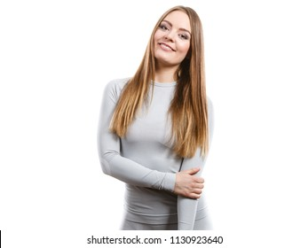 Clothing fashion sport concept. Fit female wearing thermoactive underwear top. Slim woman in sporty clothes