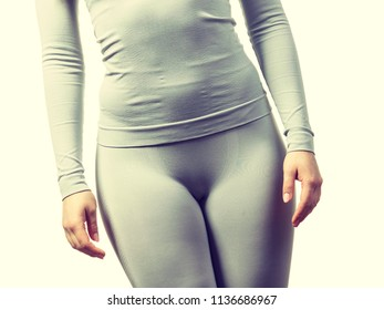 Clothing fashion sport concept. Fit female hips body wearing thermoactive underwear. Slim woman in sporty clothes