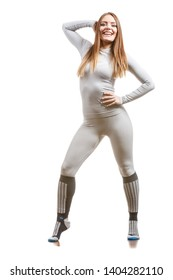 Clothing fashion sport concept. Fit female wearing thermoactive underwear, full body shot. Slim woman in sporty clothes