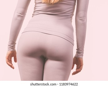 Clothing fashion sport concept. Part body picture with thermoactive underwear. Attractive fit woman promoting sporty clothes.