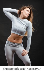 Clothing fashion sport concept. Sporty woman wearing thermoactive underwear. Attractive sporty lady promoting clothes and showing her slim abdomen.