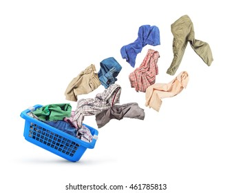 Clothing is flying from the basket on a white background