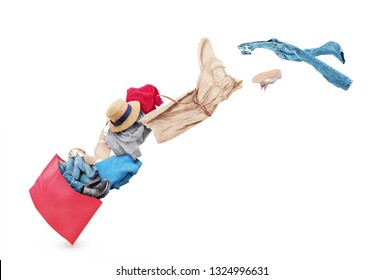 Clothing is flying from the paper bag on a white background