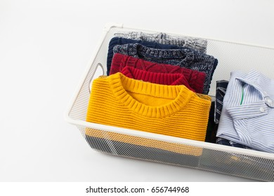 Clothing folded for vertical storage in the linen drawer. Place for text.