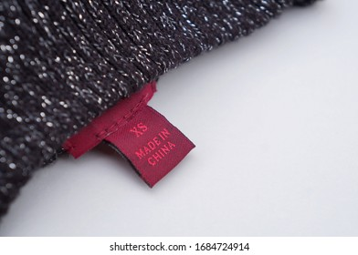 Clothing label Made in China. China product. XS clothing label.