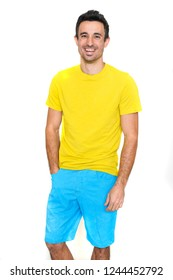 Clothing model posing in a plain yellow t-shirt and short blue pants