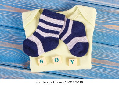 Clothing for newborn and word boy, concept of expecting for baby and extending family