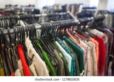 Clothing on hangers in the second-hand store.