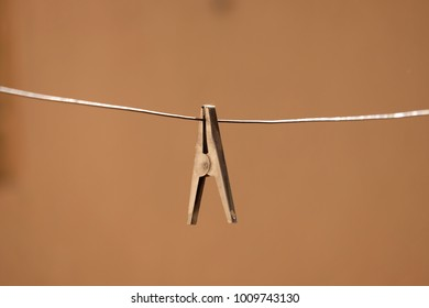 A clothing pin, clip on metal string