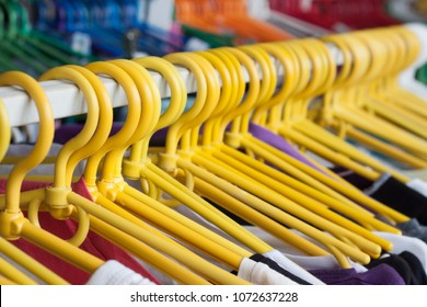 Clothing rack. Hangers in the clothes store. Shallow dof.