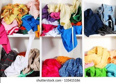 Clothing scattered on shelves