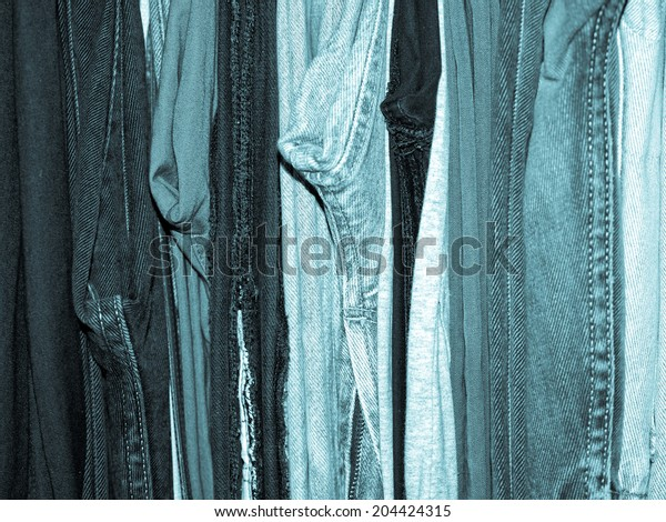 Clothing in a wardrobe closet - cool cyanotype