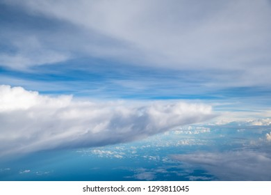 cloud above sky, trangle shape cloud on sky.