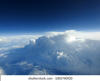 Cloud abstract from airplane window / In meteorology, a cloud is an aerosol comprising a visible mass of minute liquid droplets, frozen crystals, or particles suspended in the atmosphere