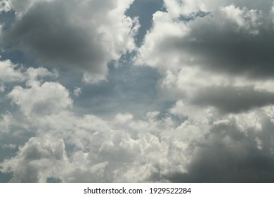Cloud is an aerosol consisting of a visible mass of minute liquid droplets, frozen crystals or other particles suspended in the atmosphere